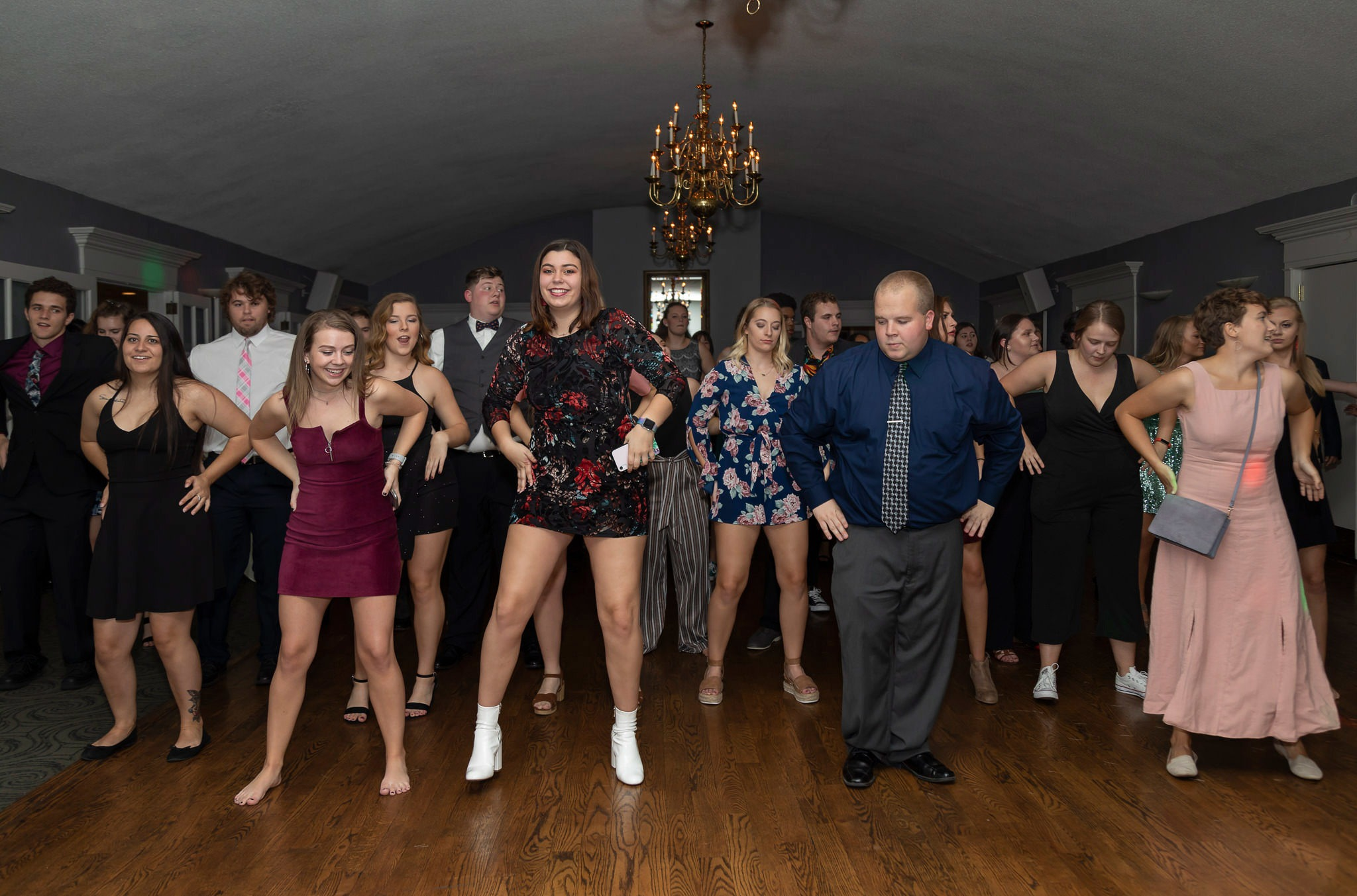 A photo of college students line dancing at the Fall formal.
